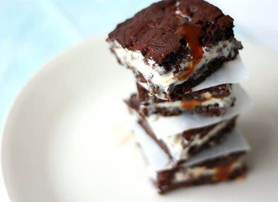 """A brownie sundae made into a hand-held snack is something we can definitely get behind -- and that's essentially what this ice cream sandwich is. <strong>Get the <a href=""""http://www.yummymummykitchen.com/2011/07/brownie-and-salted-caramel-ice-cream.html"""" rel=""""nofollow noopener"""" target=""""_blank"""" data-ylk=""""slk:Brownie and Salted Caramel Ice Cream Sandwiches recipe"""" class=""""link rapid-noclick-resp"""">Brownie and Salted Caramel Ice Cream Sandwiches recipe</a></strong>"""