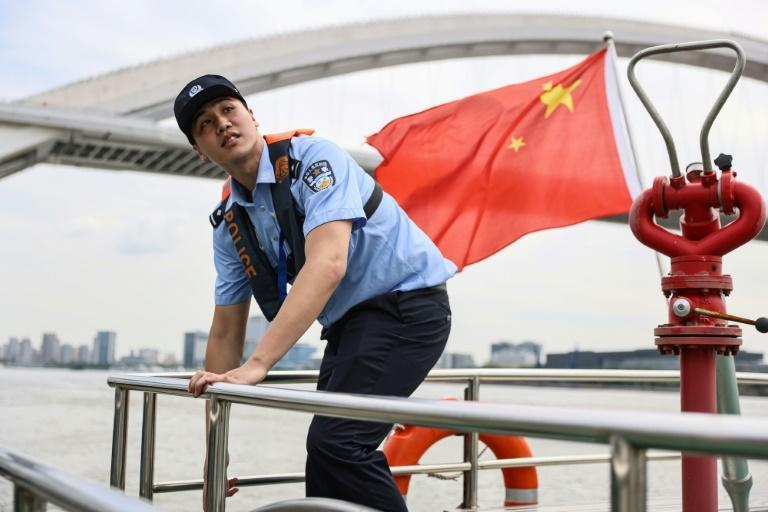 Chinese police officer Jiang Haiqi is an Olympic medal-winning swimmer
