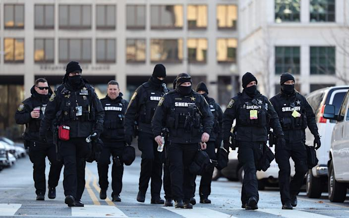 Members of the Loudon County Virginia sheriff department patrol in Washington DC - Michael M. Santiago/Getty Images North America