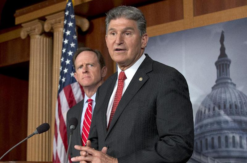 FILE - In this April 10, 2013 file photo, Sen. Joe Manchin, D-W.Va., right, accompanied by Sen. Patrick Toomey, R-Pa., announce that they have reached a bipartisan deal on expanding background checks to more gun buyers,, on Capitol Hill in Washington. The number of Republican senators who might back expanded background checks is now dwindling, threatening a bipartisan effort to subject more gun buyers to the checks. A vote on the compromise, the heart of Congress' gun control effort, is expected this week.  (AP Photo/J. Scott Applewhite, File)