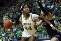 FILE - In this March 1, 2020, file photo, Oregon forward Ruthy Hebard (24) drives to the basket as Washington forward Mai-Loni Henson defends during an NCAA college basketball game in Eugene, Ore. The Chicago Sky chose Hebard with the eighth pick in the WNBA draft Friday, April 17, 2020. (AP Photo/Thomas Boyd, File)