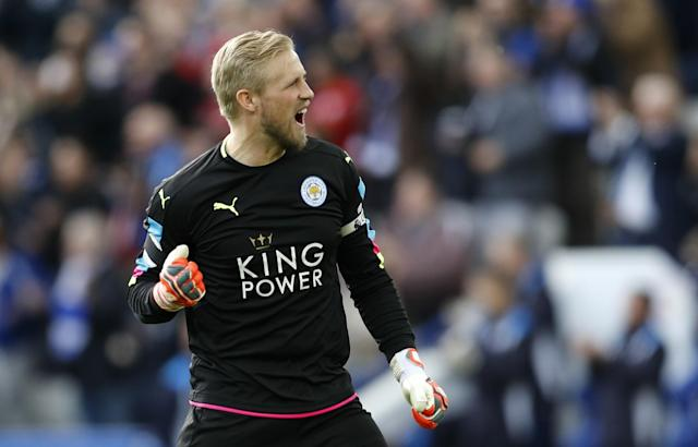 <p>Leicester City's Kasper Schmeichel celebrates after the second goal scored by Jamie Vardy (not pictured) </p>