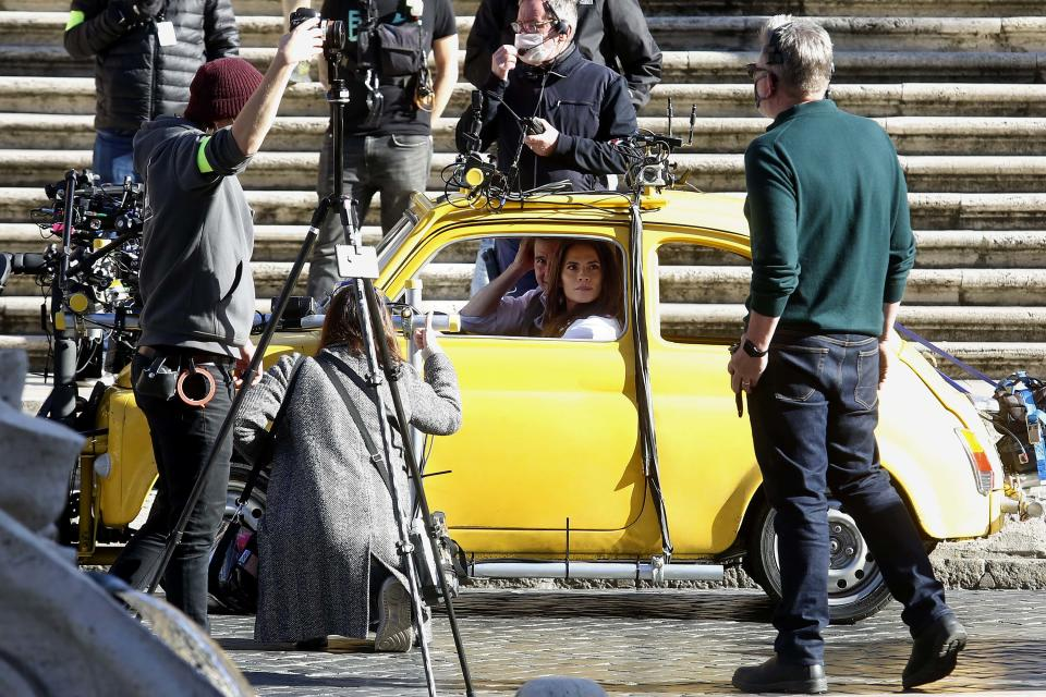 Actor Tom Cruise and actress Hayley Atwell in a Fiat yellow 500 driven by a stuntman, during a an action scene on the set of the film Mission Impossible 7 at Spagna square, just under the Spanish steps. Rome (Italy), November 22nd 2020 (Photo by Samantha Zucchi/Insidefoto/Mondadori Portfolio via Getty Images)
