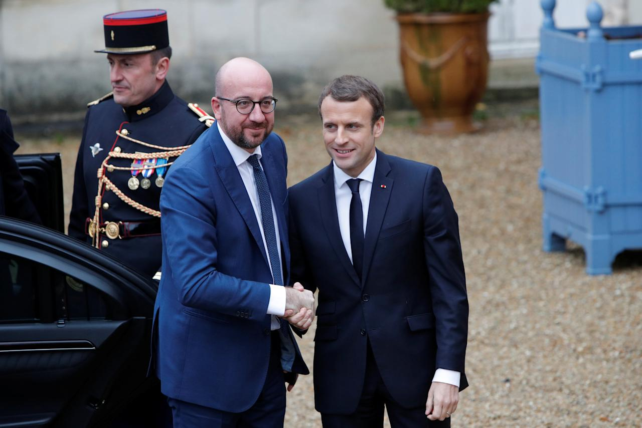 Prime Minister of Belgium Charles Michel is greeted by French President Emmanuel Macron as he hosts the leaders of the G5 Sahel countries - Mali, Burkina Faso, Niger, Chad and Mauritania, as well as Germany, Italy and and Saudi Arabia to discuss how to speed up the implementation of the G5 West African counter-terrorism force in La Celle Saint Cloud, near Paris, December 13, 2017. REUTERS/Philippe Wojazer