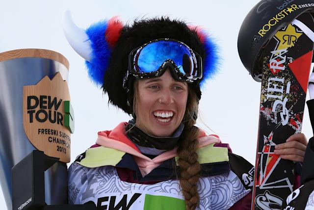 BRECKENRIDGE, CO - DECEMBER 13: Maddie Bowman celebrates on the podium after winning the women's ski superpipe at the Dew Tour iON Mountain Championships on December 13, 2013 in Breckenridge, Colorado. (Photo by Doug Pensinger/Getty Images)