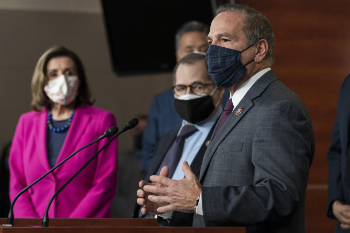 Rep. David Cicilline, D-R.I., right, with Senate House Speaker Nancy Pelosi of Calif., left, and Sen. Jerry Nadler, D-N.Y., speaks about the Congress Equality Act, Thursday, Feb. 25, 2021, on Capitol Hill in Washington. Rep. Mark Takano, D-Calif., is behind Nadler. (AP Photo/Jacquelyn Martin)
