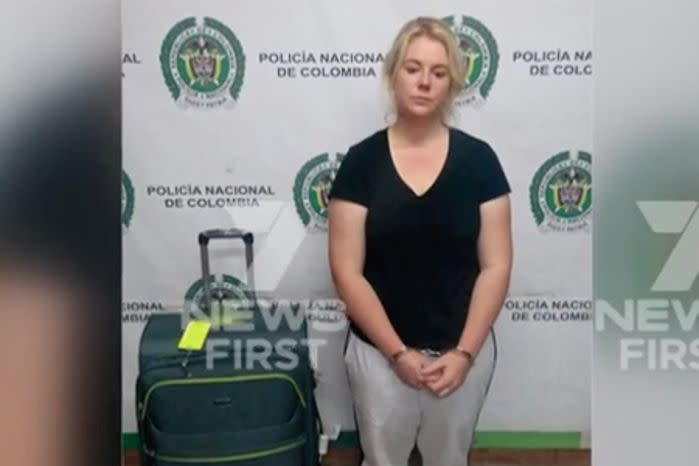 Australian Cassandra Sainsbury in handcuffs after she was arrested at the international airport in Bogota. Source: 7 News