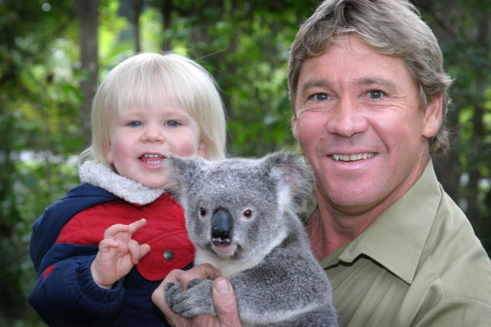 'Crocodile Hunter' Steve Irwin with his son, Bob Irwin, and a Koala at Australia Zoo