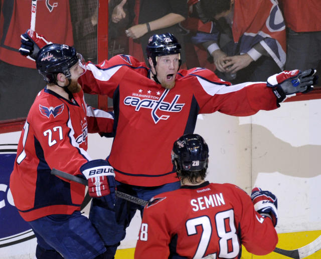 Washington Capitals left wing Jason Chimera (25) celebrates a goal against the New York Rangers with teammates defenseman Karl Alzner (27) and left wing Alexander Semin (28) in the second period of Game 6 of a second-round NHL hockey Stanley Cup playoff series in Washington, Wednesday, May 9, 2012. (AP Photo/Susan Walsh)