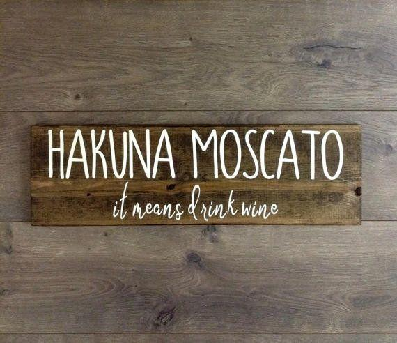 "This rustic sign will complement any at-home bar or kitchen space. Get it on <a href=""https://www.etsy.com/listing/521388333/hakuna-moscato-wine-wooden-signwine?ga_order=most_relevant&ga_search_type=all&ga_view_type=gallery&ga_search_query=wine%20lover&ref=sr_gallery_16"" target=""_blank"">Etsy</a>."