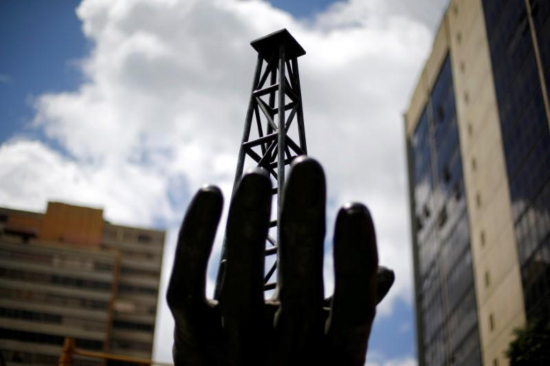 FILE PHOTO: A sculpture is seen outside a building of Venezuela's state oil company PDVSA in Caracas