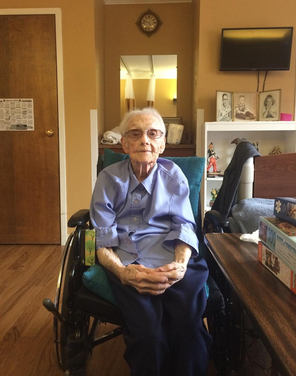 Barbara Duvall, 99, sits in her room at Newburgh Health Care in Newburgh, Indiana in 2020.