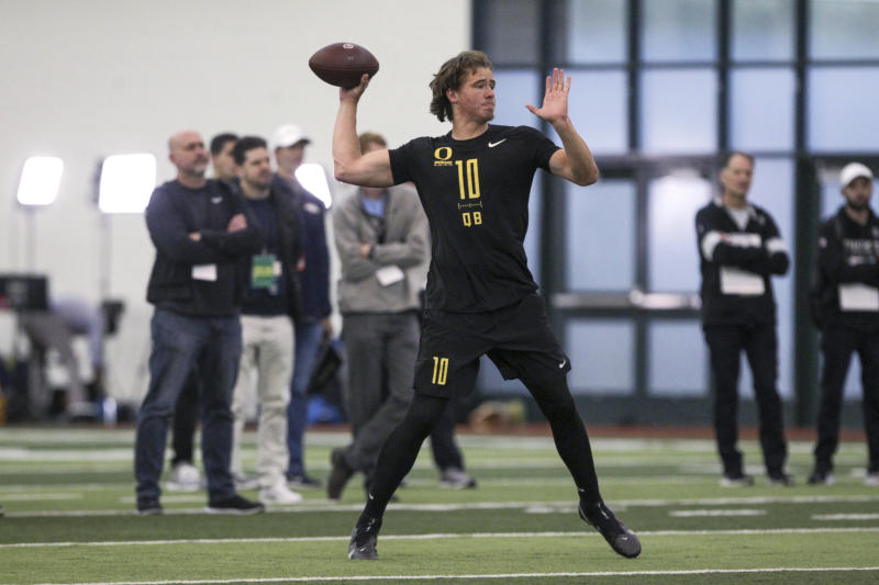 Quarterback Justin Herbert works out during Oregon football pro day in Eugene, Ore., Thursday, March 12, 2020. (AP Photo/Collin Andrew)