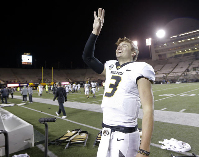Missouri quarterback Drew Lock waves to fans after beating Vanderbilt in an NCAA college football game Saturday, Nov. 18, 2017, in Nashville, Tenn. Missouri won 45-17. (AP Photo/Mark Humphrey)