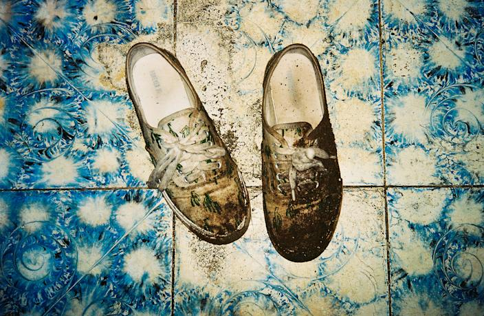 June 27, 2016 - Muddy shoes after crossing the border into Honduras atnight. (Photo: Lisette Poole)