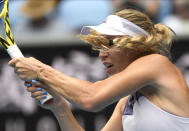 Denmark's Caroline Wozniacki makes a backhand return to Dayana Yastremska of Ukraine during their second round singles match at the Australian Open tennis championship in Melbourne, Australia, Wednesday, Jan. 22, 2020. (AP Photo/Andy Brownbill)