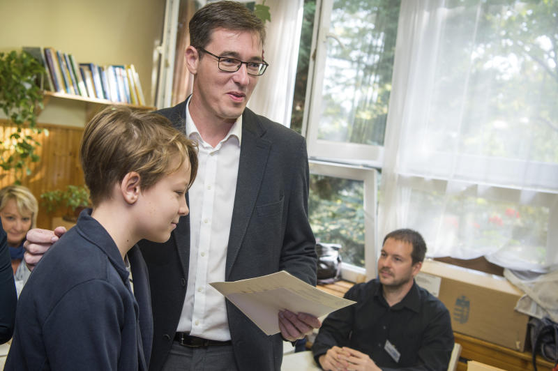 Candidate of most of the oppositional parties for the mayor of Budapest Gergely Karacsony is accompanied by his son, name not given, as he prepares to vote at the nationwide local elections in Budapest, Hungary, Sunday, Oct. 13, 2019. (Zoltan Balogh/MTI via AP)