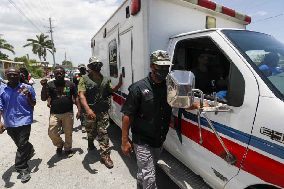 An ambulance carrying former Haitian President Jean-Bertrand Aristide leaves the airport after his arrival from Cuba, where he underwent medical treatment, in Port-au-Prince, Haiti, Friday, July 16, 2021. President Jovenel Moise was assassinated at his home on July 7. (AP Photo/Fernando Llano)