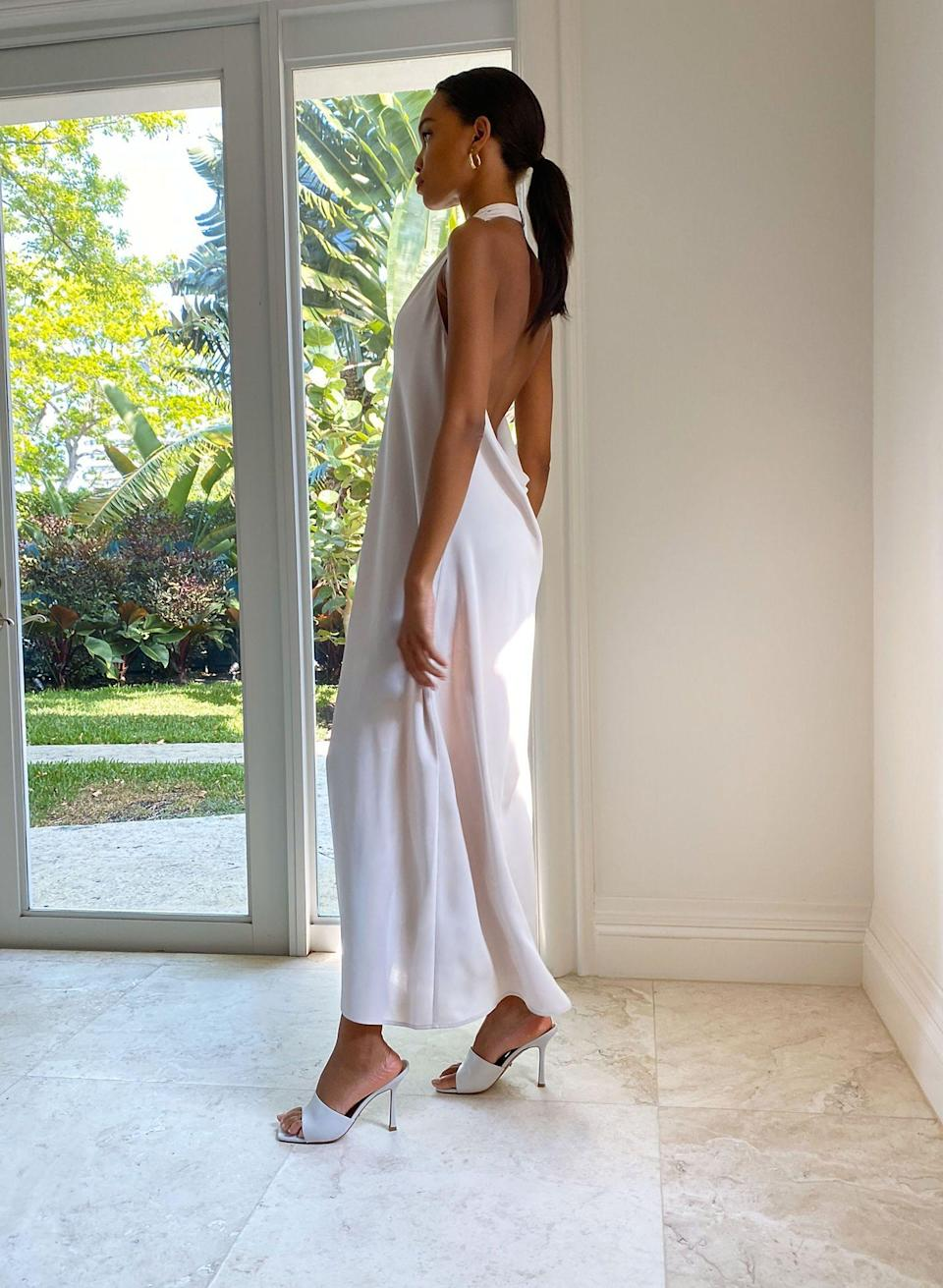"""<p><strong>Babaton</strong></p><p>aritzia.com</p><p><strong>$128.00</strong></p><p><a href=""""https://www.aritzia.com/us/en/product/britannic-dress/78196.html"""" rel=""""nofollow noopener"""" target=""""_blank"""" data-ylk=""""slk:SHOP IT"""" class=""""link rapid-noclick-resp"""">SHOP IT</a></p><p>This halter dress is a great combination of sleek and romantic. The low back and front slit is a sexy option for any of brides-to-be looking for a bridal shower or rehearsal dress. </p>"""