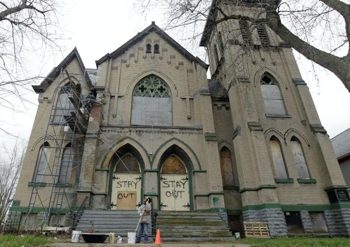 """<span class=""""caption"""">A 2012 photograph of the Sunrise Church of Christ in Buffalo's East Side. The building has since been demolished.</span> <span class=""""attribution""""><a class=""""link rapid-noclick-resp"""" href=""""http://www.apimages.com/metadata/Index/New-York-Daily-Life/79d704cfa6e04ba88f6d678f9af9d61b/2/0"""" rel=""""nofollow noopener"""" target=""""_blank"""" data-ylk=""""slk:AP Photo/David Duprey"""">AP Photo/David Duprey</a></span>"""