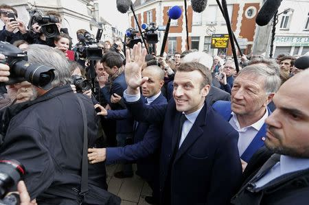 Emmanuel Macron, head of the political movement En Marche ! (or Onwards !) and candidate for the 2017 presidential election, is surrounded by journalists as part of a campaign visit in Villers-Cotterets