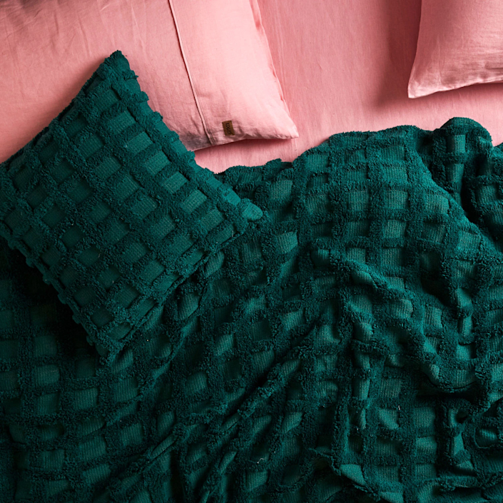 """<h3><strong>Kip&Co</strong></h3> <br><br><strong>Best For: Boutique Bedding<br></strong>This boutique home brand from Melbourne has just the right products to bring an uplifting makeover to your home. Featuring candy-colored linens, galaxy-print throws, tasseled cushions and a variety of bath products, this retailer is the secret to creating an Insta-worthy apartment.<br><br><strong><em><a href=""""https://kipandco.com/shop.html"""" rel=""""nofollow noopener"""" target=""""_blank"""" data-ylk=""""slk:Shop Kip&Co"""" class=""""link rapid-noclick-resp"""">Shop Kip&Co</a></em></strong><br><br><strong>Kip & Co.</strong> Deep Lake Chenille Cushion, $, available at <a href=""""https://go.skimresources.com/?id=30283X879131&url=https%3A%2F%2Fkipandco.com%2Fcollections%2Fcushions%2Fproducts%2Fdeep-lake-chenille-cushion"""" rel=""""nofollow noopener"""" target=""""_blank"""" data-ylk=""""slk:Kip & Co."""" class=""""link rapid-noclick-resp"""">Kip & Co.</a><br><br><br><br>"""