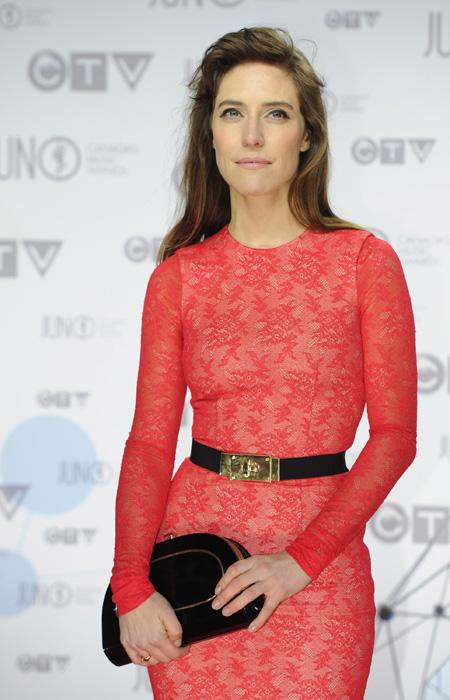 "Feist is hands down the best-dressed of the night. The ""Artist of the Year"" winner is stunning in a fitted red lace dress with a black and gold belt and matching clutch. THE CANADIAN PRESS/Sean Kilpatrick"