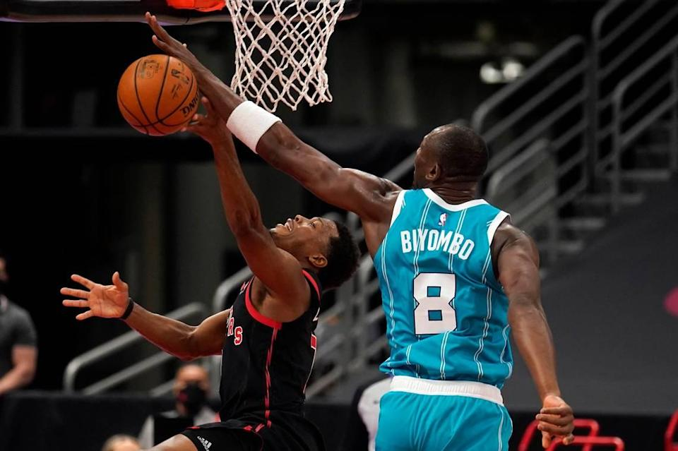 Charlotte Hornets center Bismack Biyombo (8) blocks a shot by Toronto Raptors guard Kyle Lowry (7) during the first half of Saturday's game in Tampa, Fla.