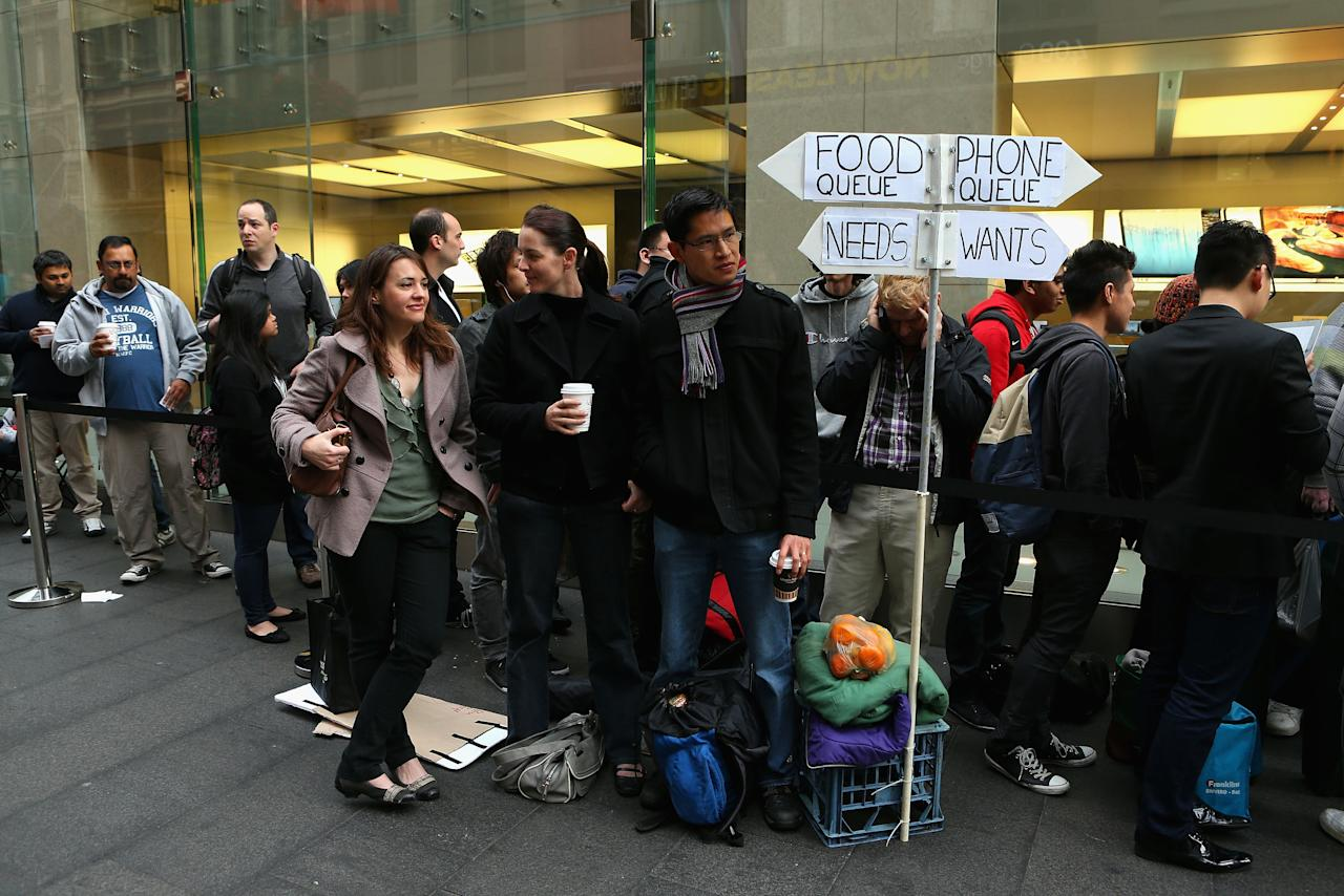 SYDNEY, AUSTRALIA - SEPTEMBER 21:  Customers queue up to purchase the iPhone 5 smartphone at the Apple flagship store on George street on September 21, 2012 in Sydney, Australia. Australian Apple stores are the first in the world to receive and sell the new iPhone 5 handsets.  (Photo by Cameron Spencer/Getty Images)