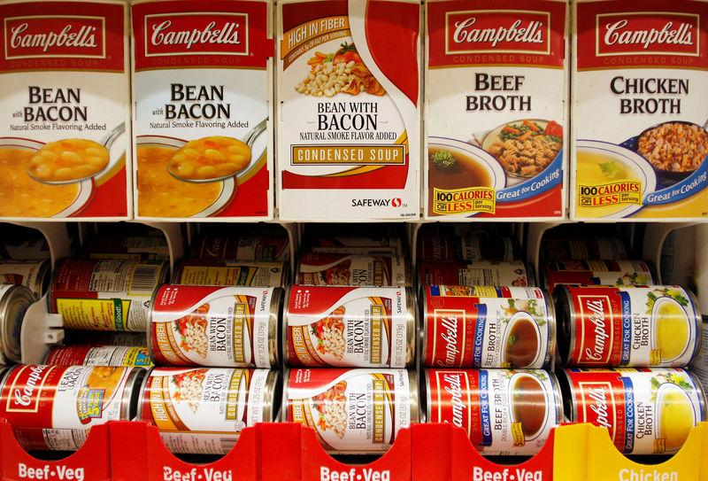 FILE PHOTO: FILE PHOTO: Cans of Campbell's Soup are stocked on a shelf at a grocery store in Phoenix