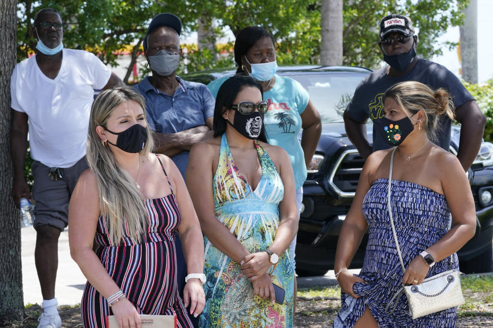 A group waits to get a COVID-19 test, Saturday, July 31, 2021, in North Miami, Fla. Federal health officials say Florida has reported 21,683 new cases of COVID-19, the state's highest one-day total since the start of the pandemic. The state has become the new national epicenter for the virus, accounting for around a fifth of all new cases in the U.S. Florida Gov. Ron DeSantis has resisted mandatory mask mandates and vaccine. (AP Photo/Marta Lavandier)