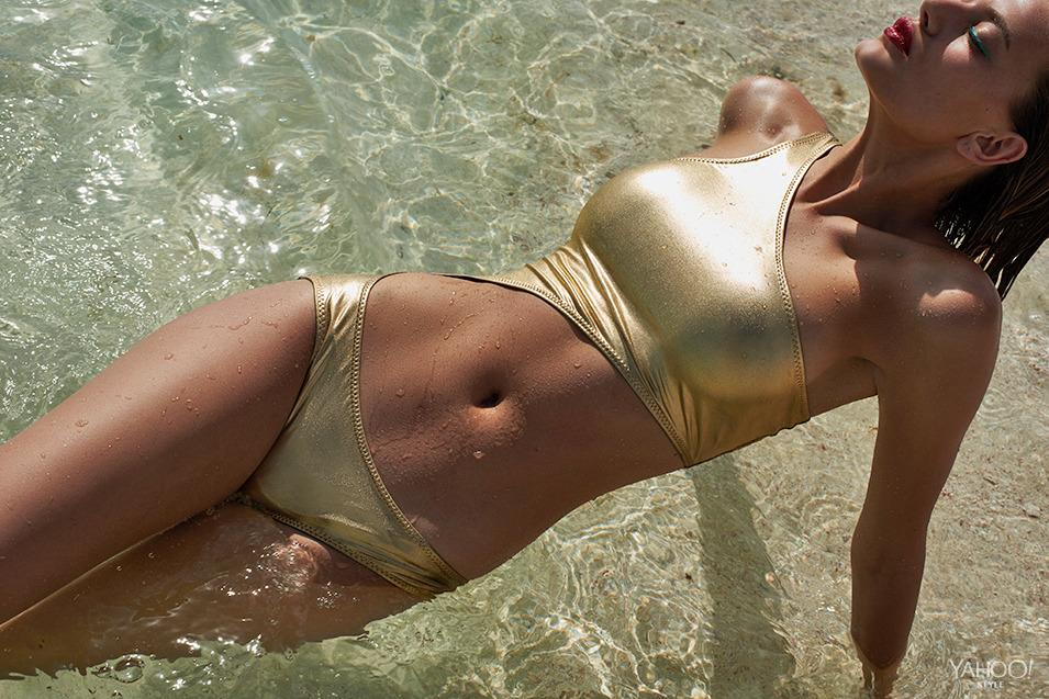 """<p>No one makes a swimsuit quite like Norma Kamali. The legendary designer's classic design gets an evening-ready update in liquid gold. Depending on where you are, it could render clothing optional for cocktail hour.<br /><br />Norma Kamali Shane Gold Nylon Lycra Foil One Piece, $240, <a href=""""http://www.normakamali.com/"""">normakamali.com</a></p>"""