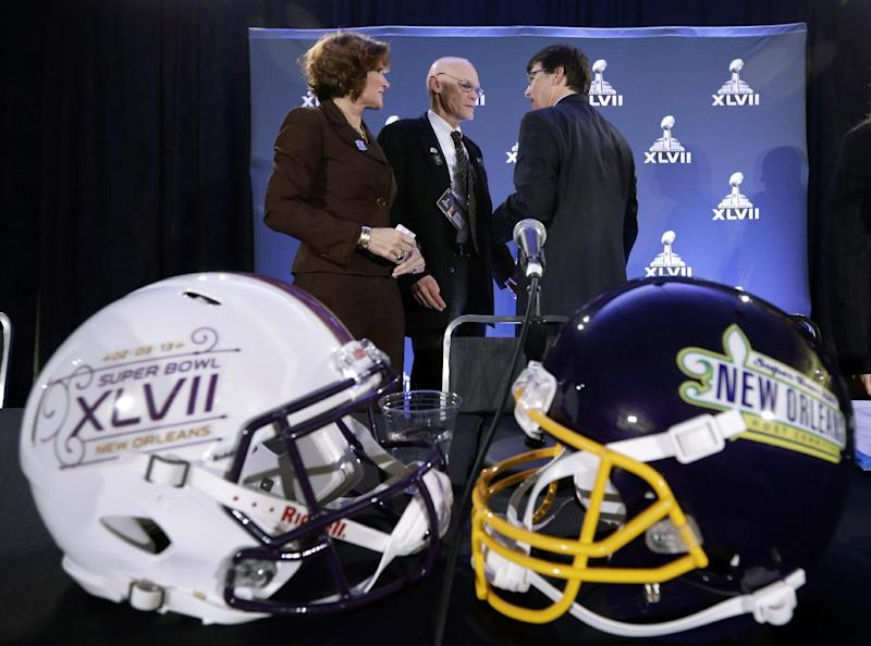 Political commentators Mary Matalin, left, and James Carville chat with Jay Cicero, president and CEO of the Greater New Orleans Sports Foundation, after speaking at an NFL football Super Bowl XLVII news conference on Monday, Jan. 28, 2013, in New Orleans. (AP Photo/Patrick Semansky)