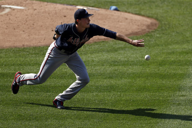 Atlanta Braves pitcher Max Fried fields a ground ball by New York Mets' Jeff McNeil during the third inning of a baseball game Saturday, July 25, 2020, in New York. (AP Photo/Adam Hunger)