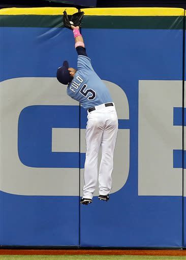 Tampa Bay Rays center fielder Sam Fuld makes a leaping catch on a fly ball hit by San Diego Padres' Will Venable during the first inning of a baseball game on Sunday, May 12, 2013, in St. Petersburg, Fla. (AP Photo/Mike Carlson)
