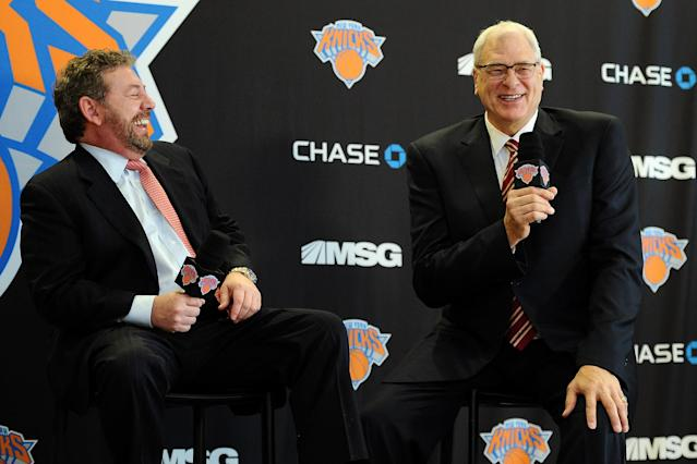 NEW YORK, NY - MARCH 18: James Dolan, L, Executive Chairman of Madison Square Garden, and Phil Jackson laugh together during the press conference to announce Jackson as the new President of the New York Knicks at Madison Square Garden on March 18, 2014 in New York City. (Photo by Maddie Meyer/Getty Images)