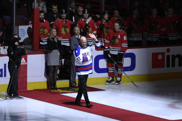 Former Chicago Blackhawks player and member of the 1980 Winter Olympics United States gold medal winning team Jack O'Callahan is honored before an NHL hockey game between the Chicago Blackhawks and New York Rangers Wednesday, Feb. 19, 2020, in Chicago. (AP Photo/Paul Beaty)