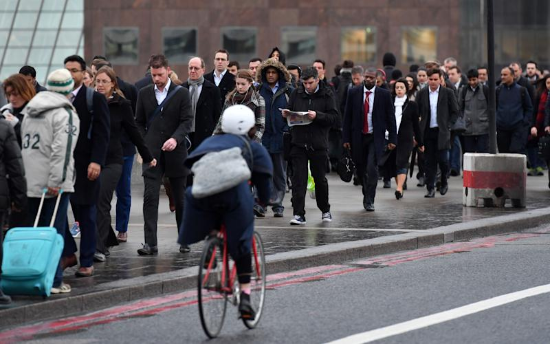 Only four per cent of Brits cycle to work - Credit: AFP