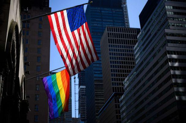 PHOTO: A rainbow flag and a U.S. flag are seen in front of the St Bartholomew's Church on June 11, 2019 in New York. (AFP via Getty Images, FILE)