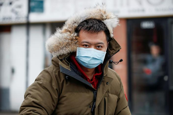 A man wears a masks in Chinatown following the outbreak of a new coronavirus, in Chicago, Illinois, U.S. January 30, 2020. REUTERS/Kamil Krzaczynski