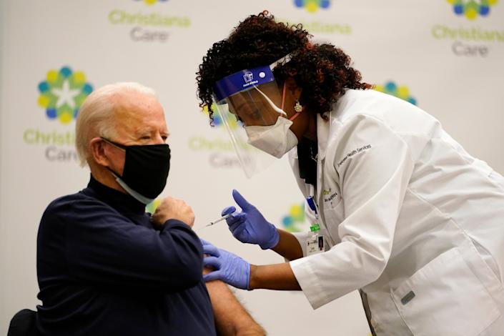 President-elect Joe Biden receives his first dose of the coronavirus vaccine at ChristianaCare Christiana Hospital in Newark, Delaware, on Monday from nurse practitioner Tabe Mase.