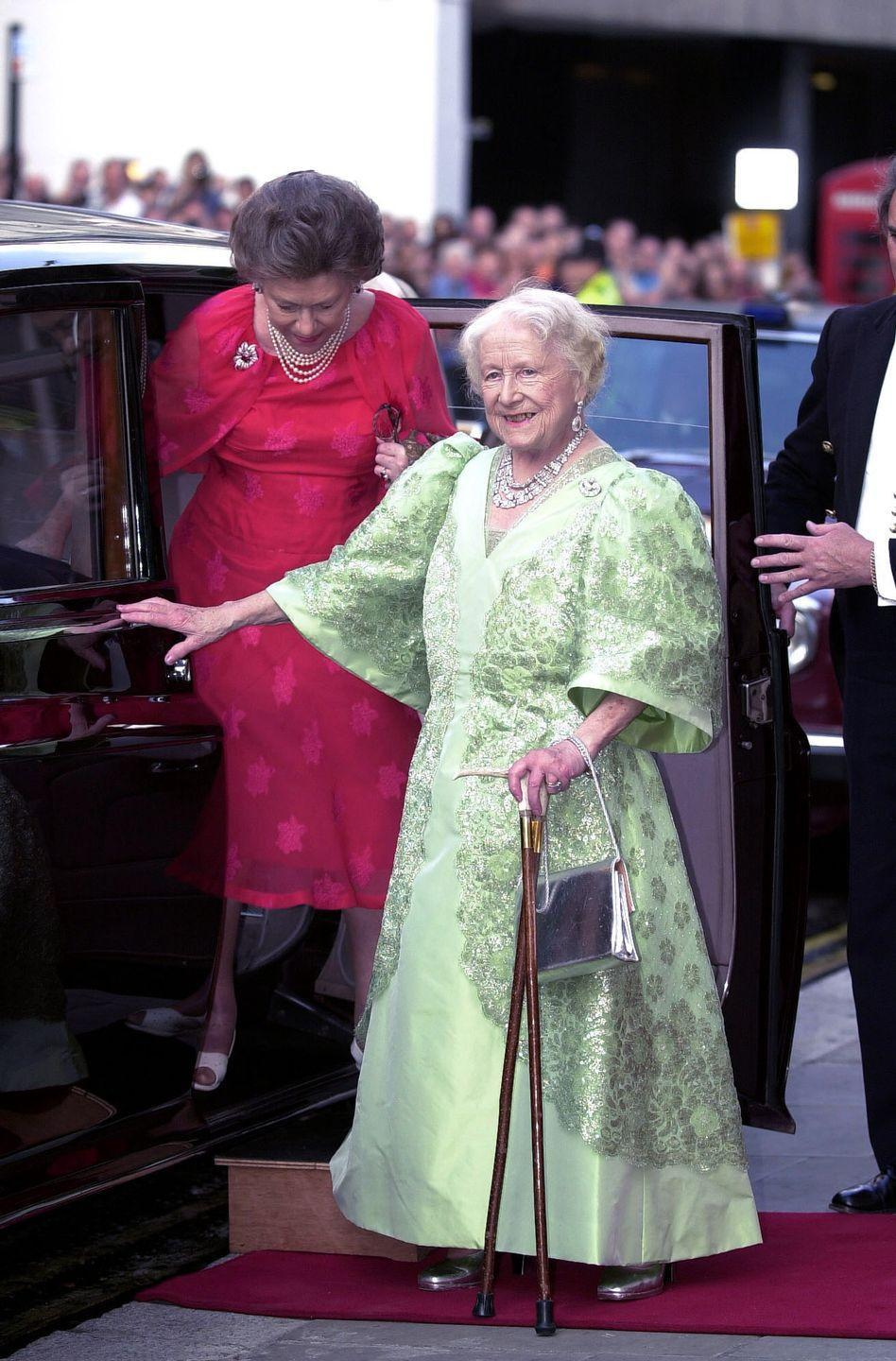 <p>As part of her 100th birthday celebration, the Queen Mother wore a pale green dress with metallic embroidery that looks just like the dress Tiana wore on her wedding day. </p>
