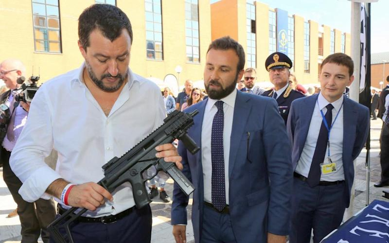 Italy's deputy prime minister, Matteo Salvini, provoked a political outcry on Monday after an aide posted a photo of him clutching a machine gun on Facebook ahead of the European elections. - Telegraph Pictures