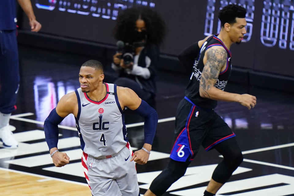 Washington Wizards' Russell Westbrook, left, reacts past Philadelphia 76ers' Danny Green after a dunk during the first half of Game 2 in a first-round NBA basketball playoff series, Wednesday, May 26, 2021, in Philadelphia. (AP Photo/Matt Slocum)