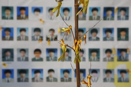 Portraits of students who died in the Sewol ferry disaster are seen behind an art installation dedicated to the victims in central Seoul November 11, 2014. REUTERS/Kim Hong-Ji