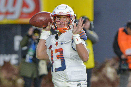 FILE - In this Nov. 17, 2018, file photo, Syracuse quarterback Tommy DeVito (13) throws a pass during an NCAA college football game against Notre Dame, at Yankee Stadium in New York. Redshirt sophomore Tommy DeVito is ready to step in. He's accumulated more experience than most backups. (AP Photo/Howard Simmons, File)