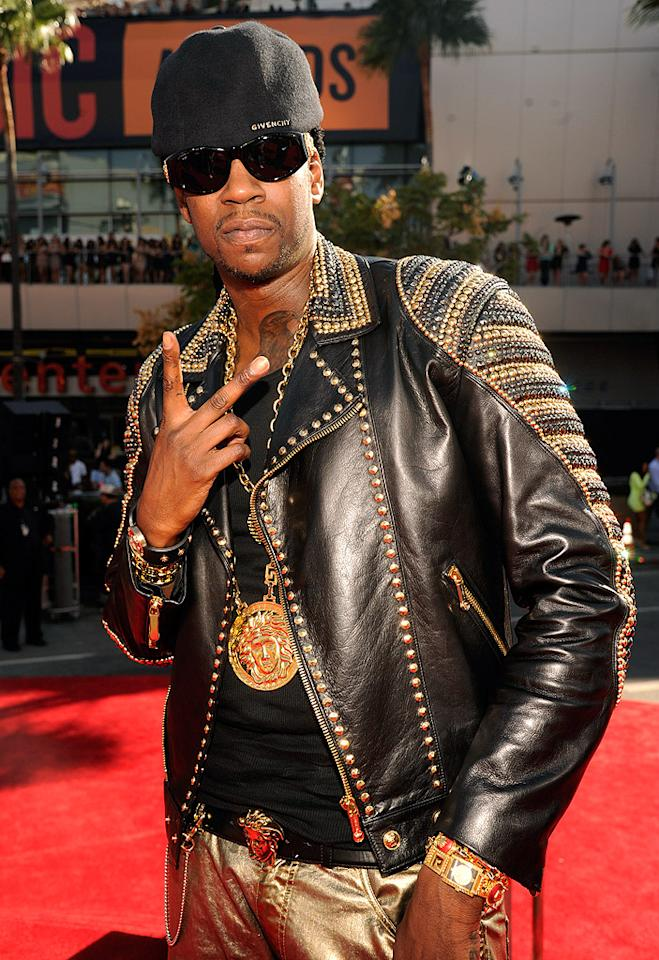 Rapper 2 Chainz made sure he stood out in gold leather pants, a studded jacket, a Givenchy cap, and lots of bling. Peace!