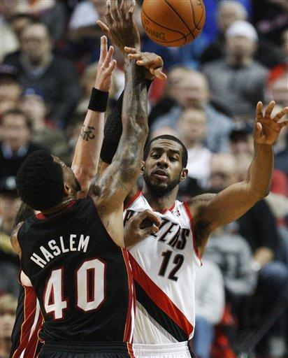 Miami Heat's Udonis Haslem (40) defends against Portland Trail Blazers' LaMarcus Aldridge (12) as Aldridge passes the ball in the second quarter during an NBA basketball game Thursday, March 1, 2012, in Portland, Ore. (AP Photo/Rick Bowmer)