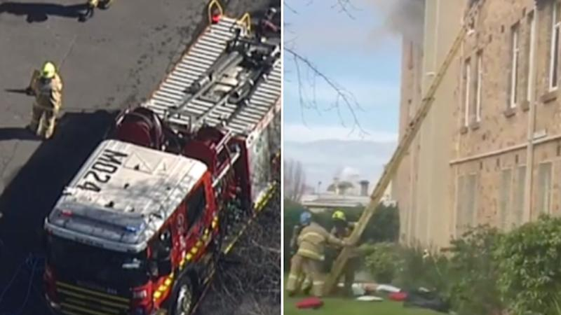 Fire crews at the scene of fire at a unit block in North Fitzroy.