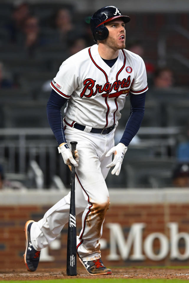 Atlanta Braves' Freddie Freeman watches his walk-off home run to right field during the 10th inning of the team's baseball game against the Milwaukee Brewers, Saturday, May 18, 2019, in Atlanta. (AP Photo/John Amis)
